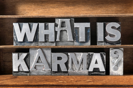 karma: what is karma question made from metallic letterpress type on wooden tray