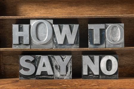 to say: how to say no phrase made from metallic letterpress type on wooden tray