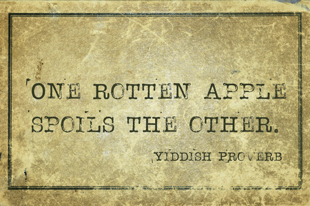 yiddish: One rotten apple spoils the other - ancient Yiddish proverb printed on grunge vintage cardboard Stock Photo