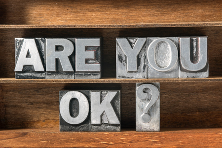 health concern: are you ok question made from metallic letterpress type on wooden tray Stock Photo