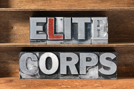 elite: elite corps phrase made from metallic letterpress type on wooden tray
