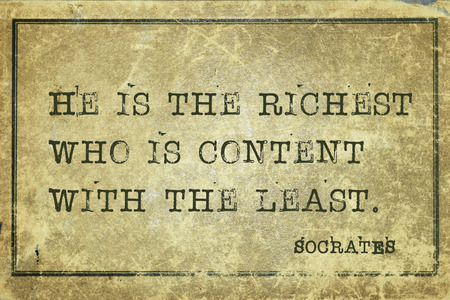 common sense: He is the richest who is content with the least - ancient Greek philosopher Socrates quote printed on grunge vintage cardboard
