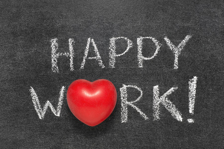 heart symbol: happy work exclamation handwritten on blackboard with heart symbol instead O Stock Photo