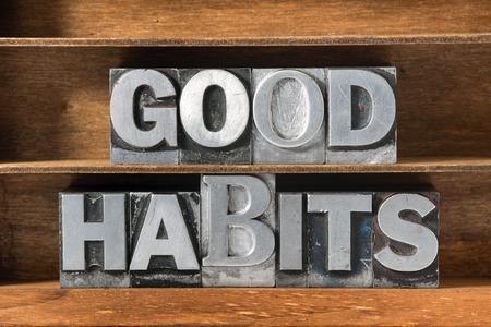 good habits: good habits phrase made from metallic letterpress type on wooden tray Stock Photo