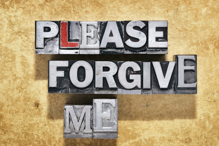 remit: please forgive me phrase made from metallic letterpress type on grunge cardboard background
