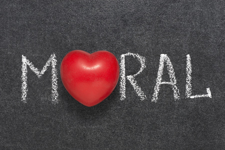 moral: moral word handwritten on blackboard with heart symbol instead O