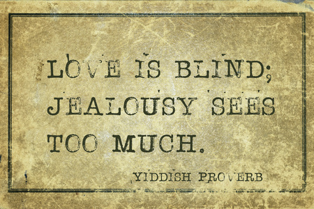 yiddish: Love is blind; jealousy sees too much - ancient Yiddish proverb printed on grunge vintage cardboard Stock Photo