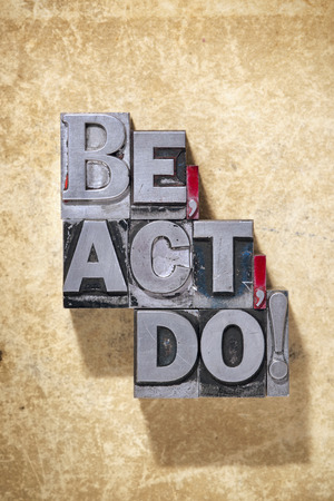letterpress words: be,act,do words made from metallic letterpress type on grunge cardboard background Stock Photo