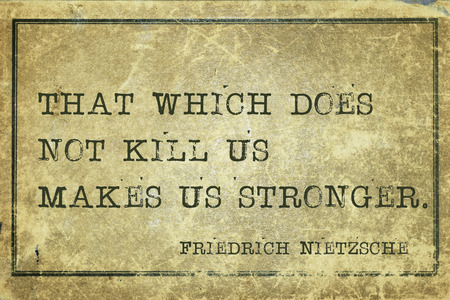ancient philosophy: That which does not kill us makes us stronger - ancient German philosopher Friedrich Nietzsche quote printed on grunge vintage cardboard