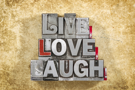 letterpress words: live, love, laugh words made from metallic letterpress type on grunge cardboard background Stock Photo