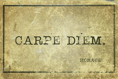 ancient philosophy: Carpe diem - ancient Roman poet Horace quote printed on grunge vintage cardboard