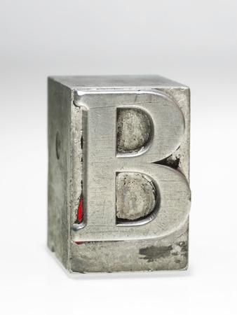 b: letter B metallic letterpress type block isolated on white