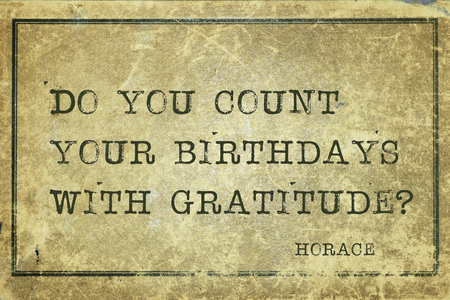 horace: Do you count your birthdays with gratitude - ancient Roman poet Horace quote printed on grunge vintage cardboard Stock Photo