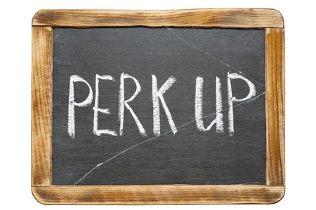 perk: perk up phrase handwritten on vintage school slate board Stock Photo