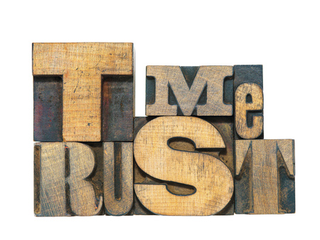 trust: trust me phrase made from mixed wooden letterpress type isolated on white