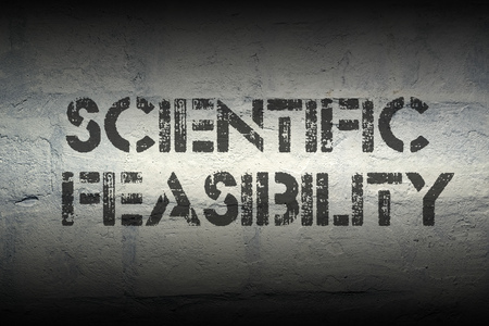 feasibility: science feasibility stencil print on the grunge white brick wall Stock Photo