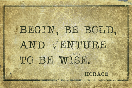 yellowish green: Begin, be bold, and venture to be wise - ancient Roman poet Horace quote printed on grunge vintage cardboard Stock Photo
