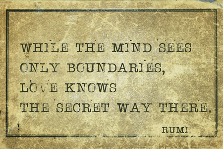 cardboard only: While the mind sees only boundaries - ancient Persian poet and philosopher Rumi quote printed on grunge vintage cardboard Stock Photo