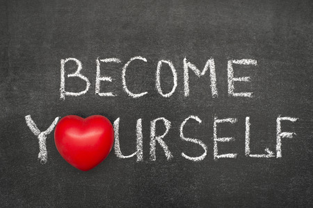 become: become yourself phrase handwritten on blackboard with heart symbol instead O