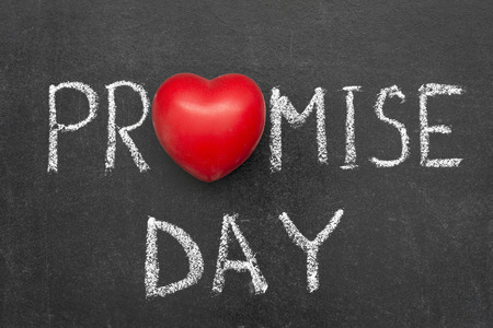 promise: promise day phrase handwritten on blackboard with heart symbol instead O