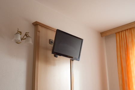 light room interior with TV panel hanged on the wall