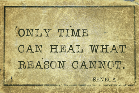 seneca: Only time can heal what reason cannot - ancient Roman philosopher Seneca quote printed on grunge vintage cardboard Stock Photo