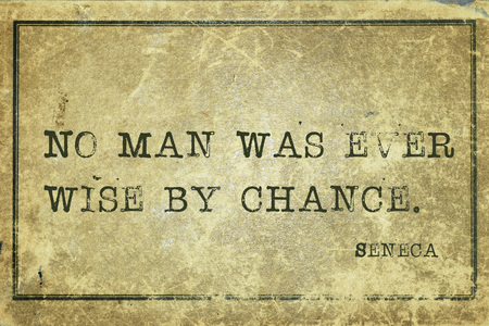 seneca: No man was ever wise by chance - ancient Roman philosopher Seneca quote printed on grunge vintage cardboard Stock Photo