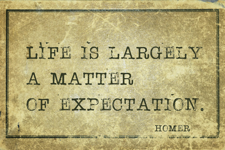Life is largely a matter of expectation  - ancient Greek poet Homer quote printed on grunge vintage cardboard
