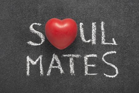 soul mates phrase handwritten on blackboard with heart symbol instead of O