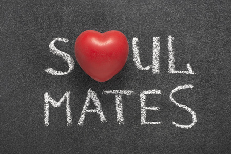 soul mates phrase handwritten on blackboard with heart symbol instead of O