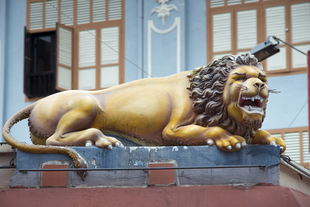 mariamman: guard lion sculpture on the wall of famous Sri Mariamman Temple located in Chinatown of Singapore