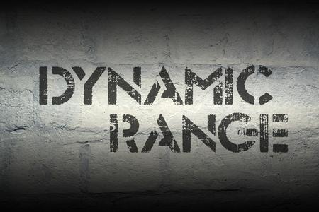 diapason: dynamic range stencil print on the grunge white brick wall Stock Photo