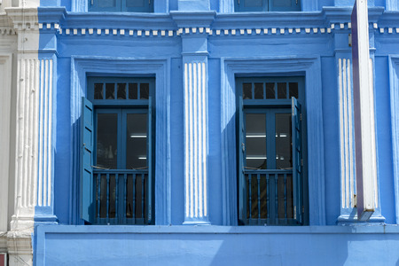 open windows: blue painted windows with open shutters in Singapore Chinatown Editorial