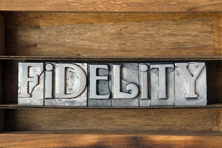 fidelity: fidelity word made from metallic letterpress type on wooden tray