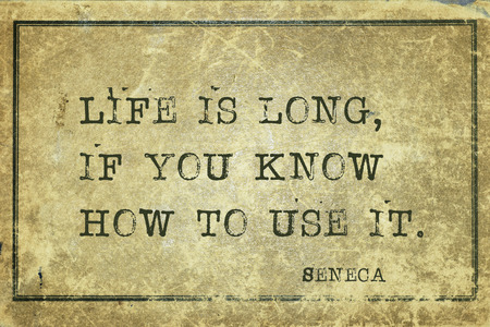 seneca: Life is long, if you know how to use it - ancient Roman philosopher Seneca quote printed on grunge vintage cardboard Stock Photo