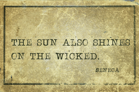 seneca: The sun also shines on the wicked - ancient Roman philosopher Seneca quote printed on grunge vintage cardboard