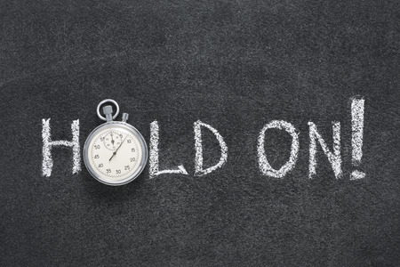 precise: hold on exclamation handwritten on chalkboard with vintage precise stopwatch used instead of O Stock Photo