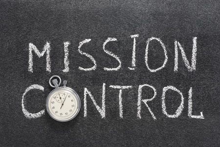 job deadline: mission control phrase handwritten on chalkboard with vintage precise stopwatch used instead of O