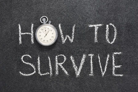 survive: how to survive phrase handwritten on chalkboard with vintage precise stopwatch used instead of O