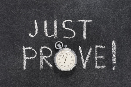prove: just prove exclamation handwritten on chalkboard with vintage precise stopwatch used instead of O