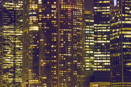 illuminated: illuminated windows of huge skyscrapers in night Singapore Stock Photo