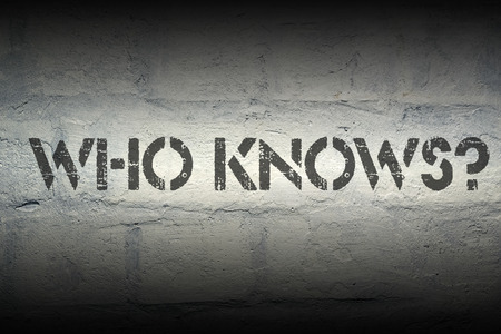 acquaintance: who knows question stencil print on the grunge white brick wall Stock Photo