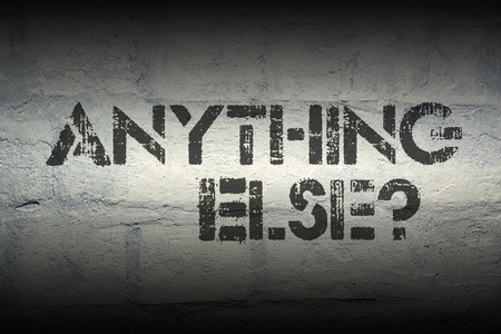 stencil: anything else question stencil print on the grunge white brick wall Stock Photo