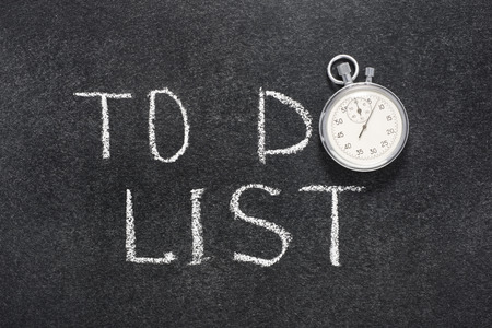 precise: to do list phrase handwritten on chalkboard with vintage precise stopwatch used instead of O