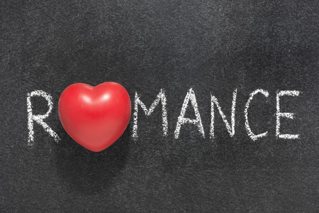 romance: romance word heart handwritten on blackboard with heart symbol instead of O