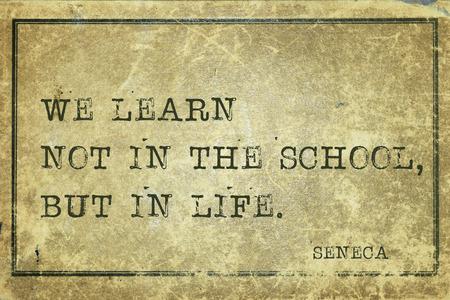 seneca: We learn not in the school - ancient Roman philosopher Seneca quote printed on grunge vintage cardboard