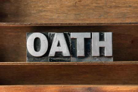 oath: oath word made from metallic letterpress type on wooden tray