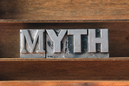 letterpress type: myth word made from metallic letterpress type on wooden tray