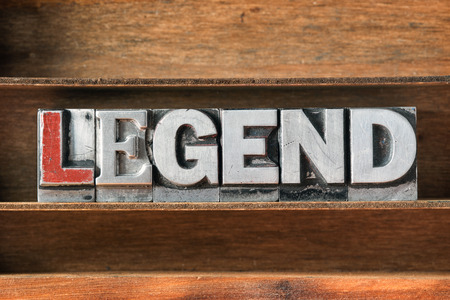 letterpress type: legend word made from metallic letterpress type on wooden tray Stock Photo