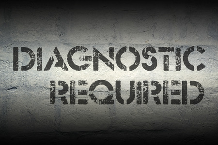 required: diagnostic required stencil print on the grunge white brick wall